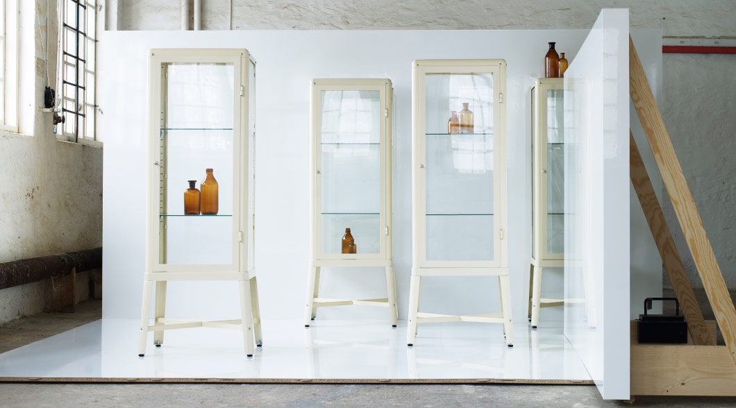 Display with FABRIKÖR glass-door cabinets in beige