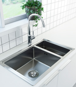 Close-up of stainless steel sink with mixer tap