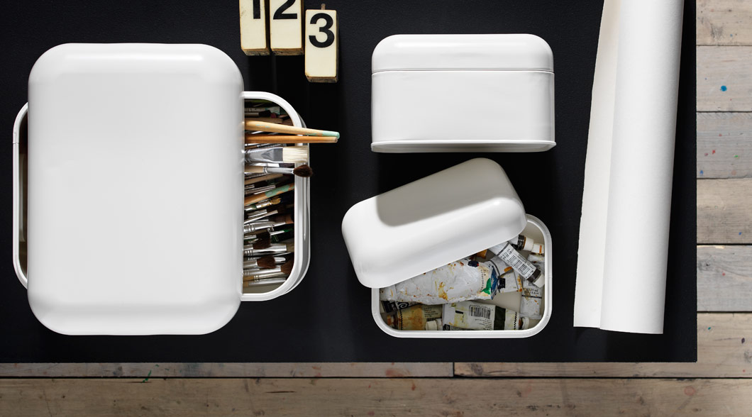 Art supplies stored in white SNIKA boxes with lids