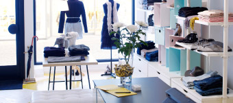 A fashion boutique with white display shelves
