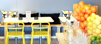 A juice bar with furniture in yellow, white and birch