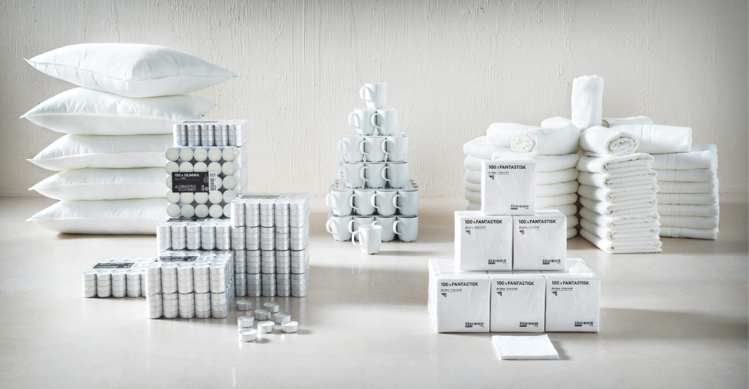 Hospitality supplies. white cushions, mugs, towels, napkins and tealights