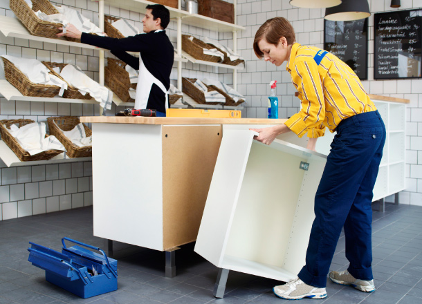 IKEA store staff assembling hospitality furniture