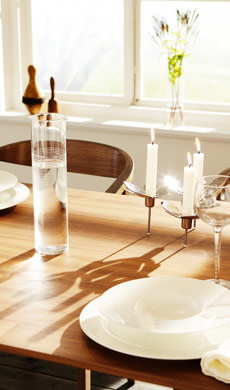 IKEA dining room with bone china dinnerware on a walnut veneer table