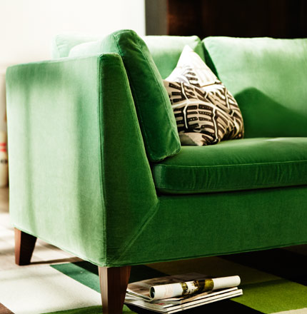 STOCKHOLM three seat sofa in Sandbacka green velvet on STOCKHOLM flatwoven rug, by IKEA