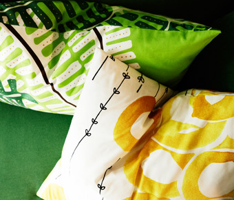 Cushion covers made from STOCKHOLM metre fabric in fern green and STOCKHOLM metre fabric in white/yellow, by IKEA