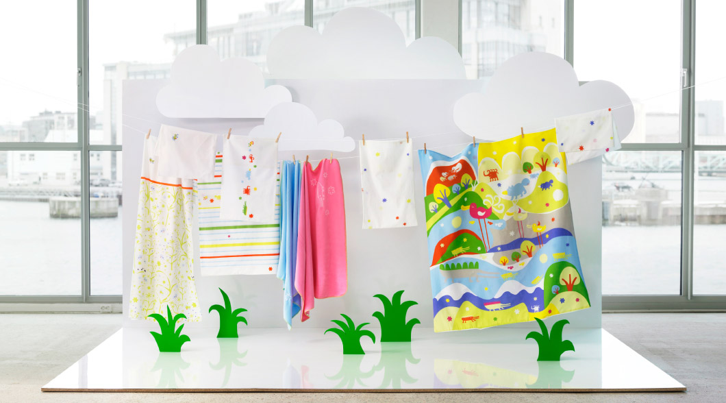 Display of bedlinen and blankets for baby