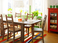 Grey-brown stained extendable dining table, chairs and red linen cabinet