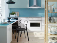 RUBRIK APPLÅD light turquoise/white kitchen with NUMERÄR double-sided countertop