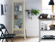 FABRIKÖR beige glass-door cabinet and STENSTORP white/oak kitchen trolley