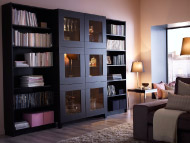 Black-brown storage combination with open shelves and tempered glass doors
