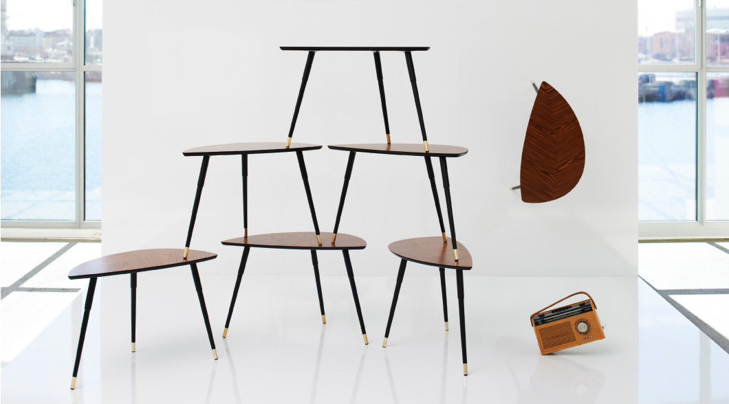 Several LÖVBACKEN side tables stacked on top of each other
