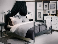 Black bed with black bedside tables and grey/black/white textiles