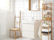 Bathroom with white wash-stand and towel rack chair, mirror and shelving unit in bamboo
