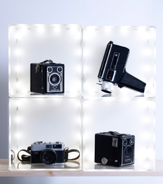 Old cameras displayed in SYNAS LED lighting box