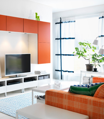 Orange and white TV storage unit in a stylish living room