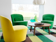 Swivel easy chairs in green and yellow with a coffee table in walnut veneer