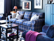 Three-seat sofa with blue checkered cover and black-brown side tables