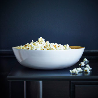 A serving bowl with popcorn