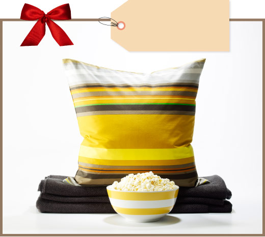 Striped cushion cover in yellow/brown/white, serving bowl in white/yellow and black throw