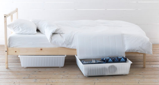 DILLING plastic bed storage boxes with lid pushed under FJELLSE bed
