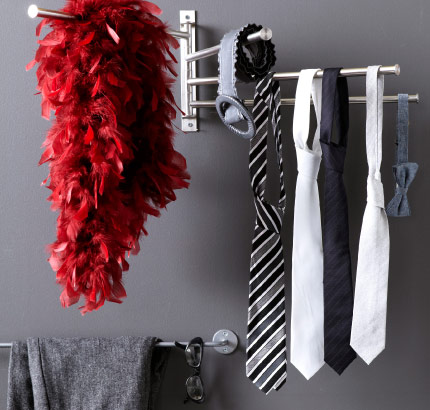 Ties and belts hanging on a stainless towel holder with four swivelling bars