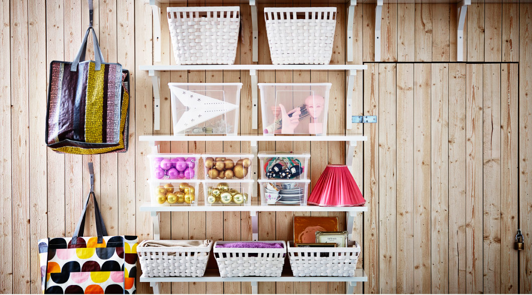 Baskets, bags and boxes stored on shelves in a utility room