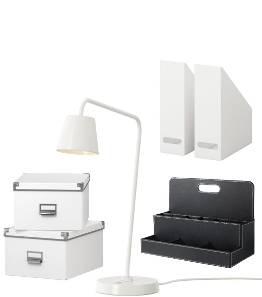 Display of boxes, magazine files, desk organiser and work lamp