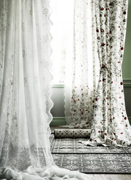 Display of sheer curtains and curtains with floral pattern