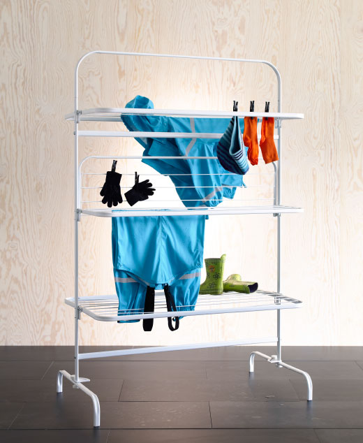 Wet clothes hanging on a foldable drying rack