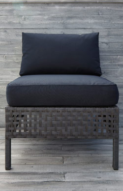 One-seat section in black-brown woven plastic rattan with black seat/back cushions