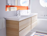Two wash-stands in white stained oak with white wash-basins and chrome taps