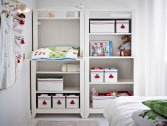 White changing table and shelf unit with storage boxes in different sizes