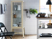 FABRIKÖR beige steel cabinet with tempered glass doors and shelves