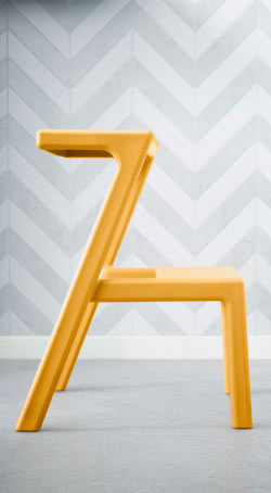 Close-up of a stackable steep stool in yellow