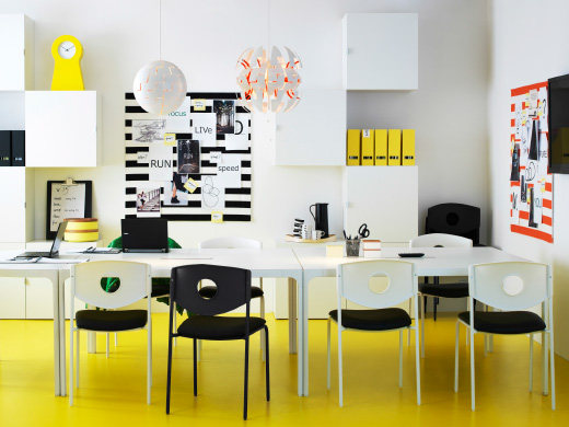 colourful office space with a yellow floor white wall cabinets and