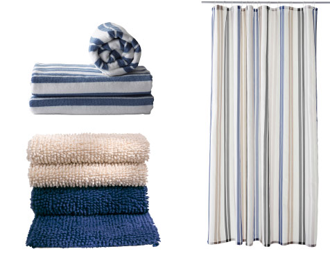 Stack of towels and a hanging striped shower curtain