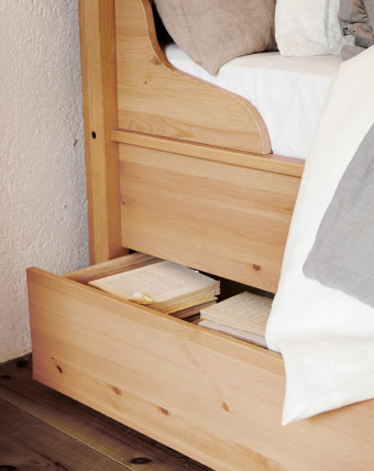 Storage space beneath solid pine bed frame