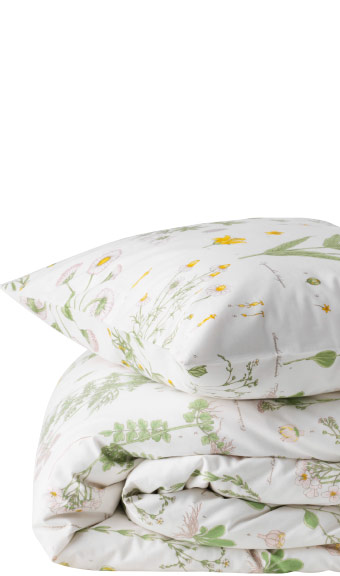 Close-up of pillow and quilt with matching linen print