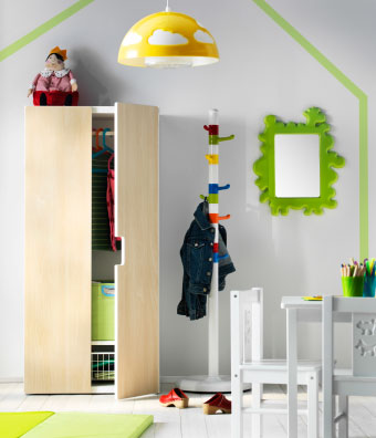 Playroom storage with a white STUVA wardrobe with birch doors and a multi-coloured KROKIG clothes stand