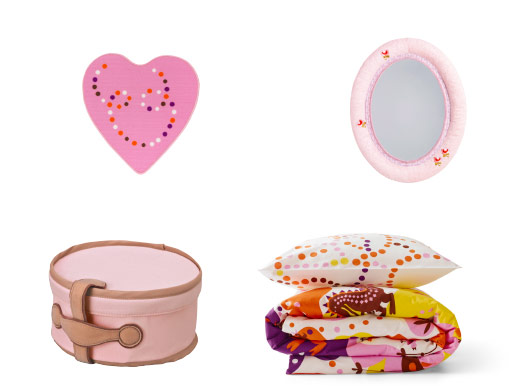 Pink rug, mirror, beauty bag and colourful printed textiles