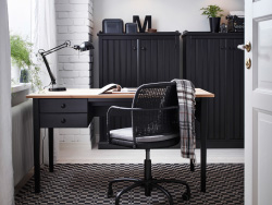 Home office design with ARKELSTORP desk and sideboard in black and wood, and GREGOR swivel chair in black