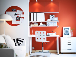 BESTÅ white wall cabinets with orange doors and EKBY JÄRPEN/EKBY BJÄRNUM white wall shelves
