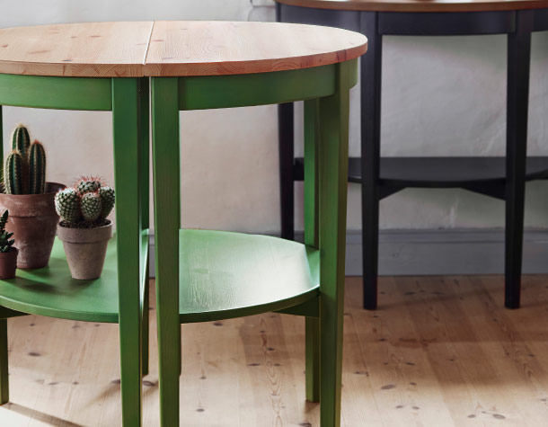Close-up of green window table with wooden top
