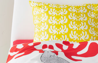 Close-up of matching pillow and quilt cover with stylish print design