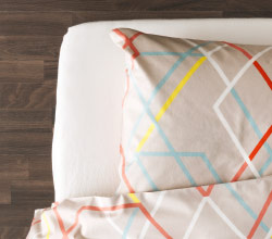 Close-up pillow and quilt cover with colourful print design