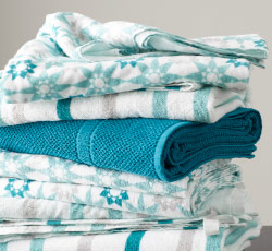 Close-up on a stack of differently styled  towels