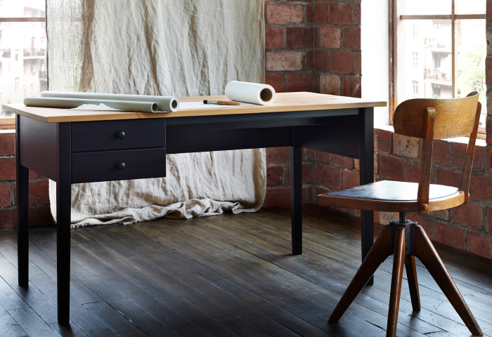 Classically designed wooden desk with rustic chair to the side