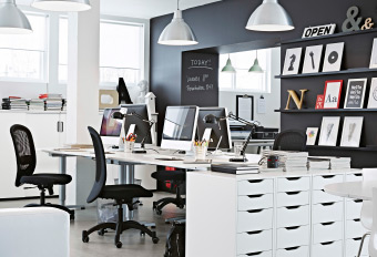 An office with furniture in white and black