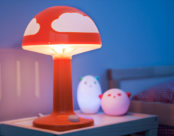 Close-up of SPÖKA LED night light in red and turquoise